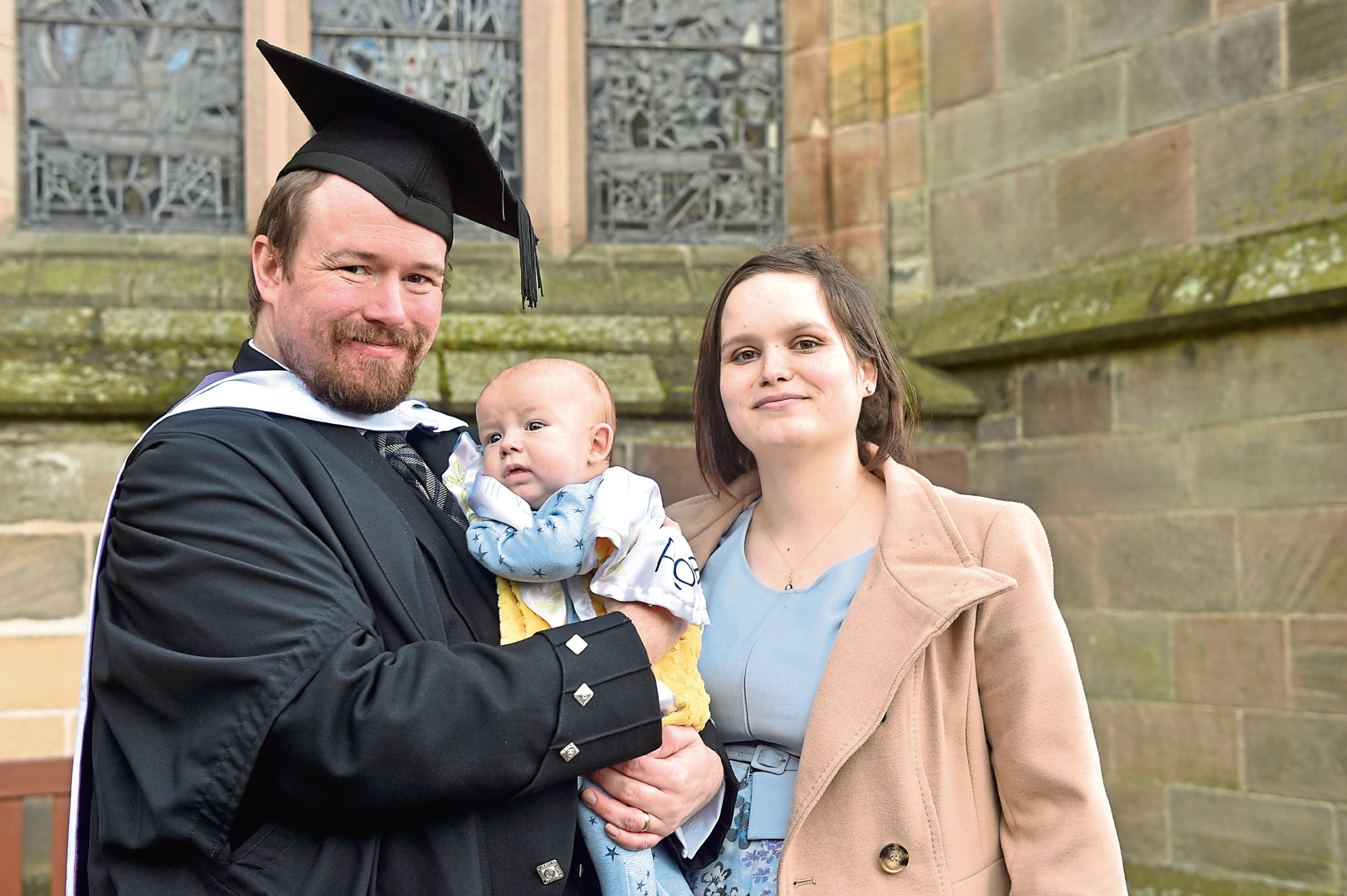 Graduate Michael McCloy with son Phoenix and wife Jacquline.