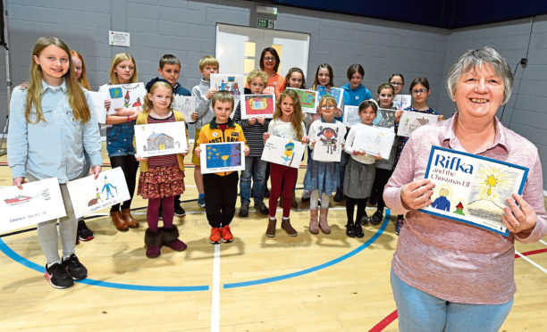Carol Ann with the winners of the children's drawing competition which led to the creation of her book