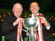 Former chairman Stewart Milne and Derek McInnes with the League Cup in 2014.