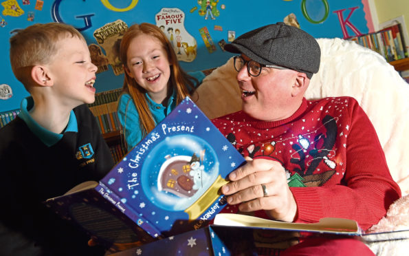 Alexander McCabe with pupils Harry MacKenzie and Sophie Rodwell of Hilton Primary School in Inverness