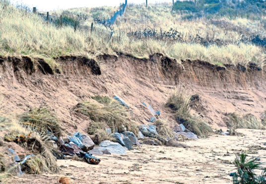 Two sets of temporary signs erected to warn walkers about dunes erosion have been vandalised