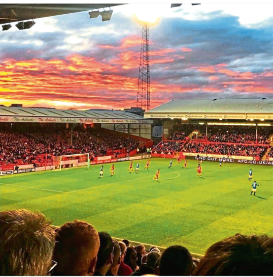 Come on you Reds! A Pittodrie scene from Deborah Grant