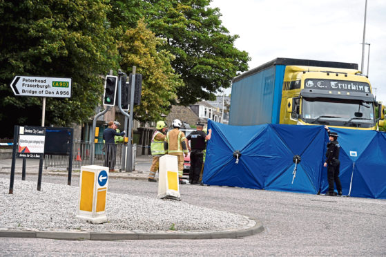 Emergency services at the scene of the accident at the St Machar Drive junction, King Street, Aberdeen, where 83-year-old Mary Allan died