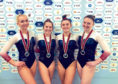Great Britain's world team silver-winning double mini trampoline (DMT) athletes, including Kim Beattie, second right.