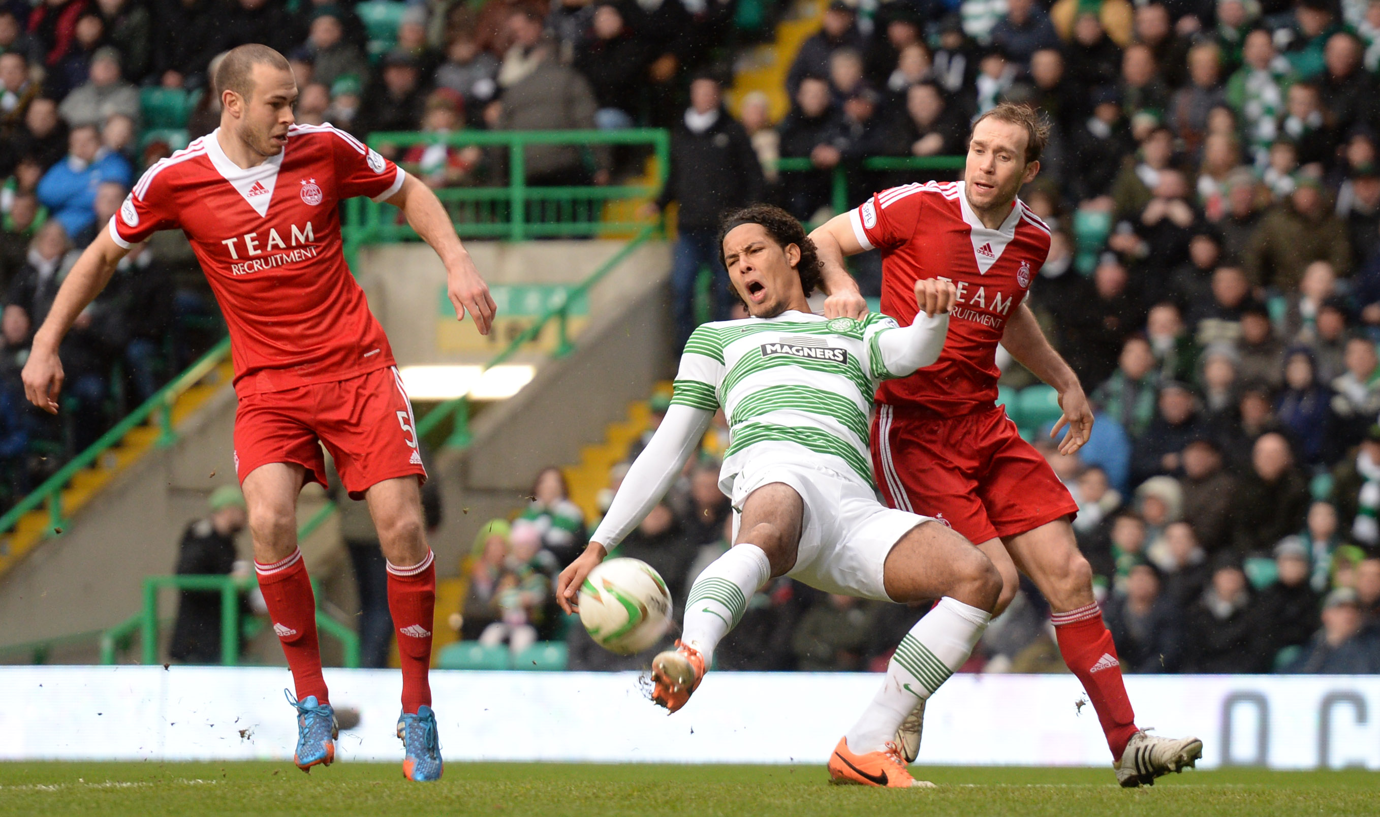 Andy Considine, left, and Russell Anderson challenge Celtic's Virgil Van Dijk at Celtic Park in  2014.
