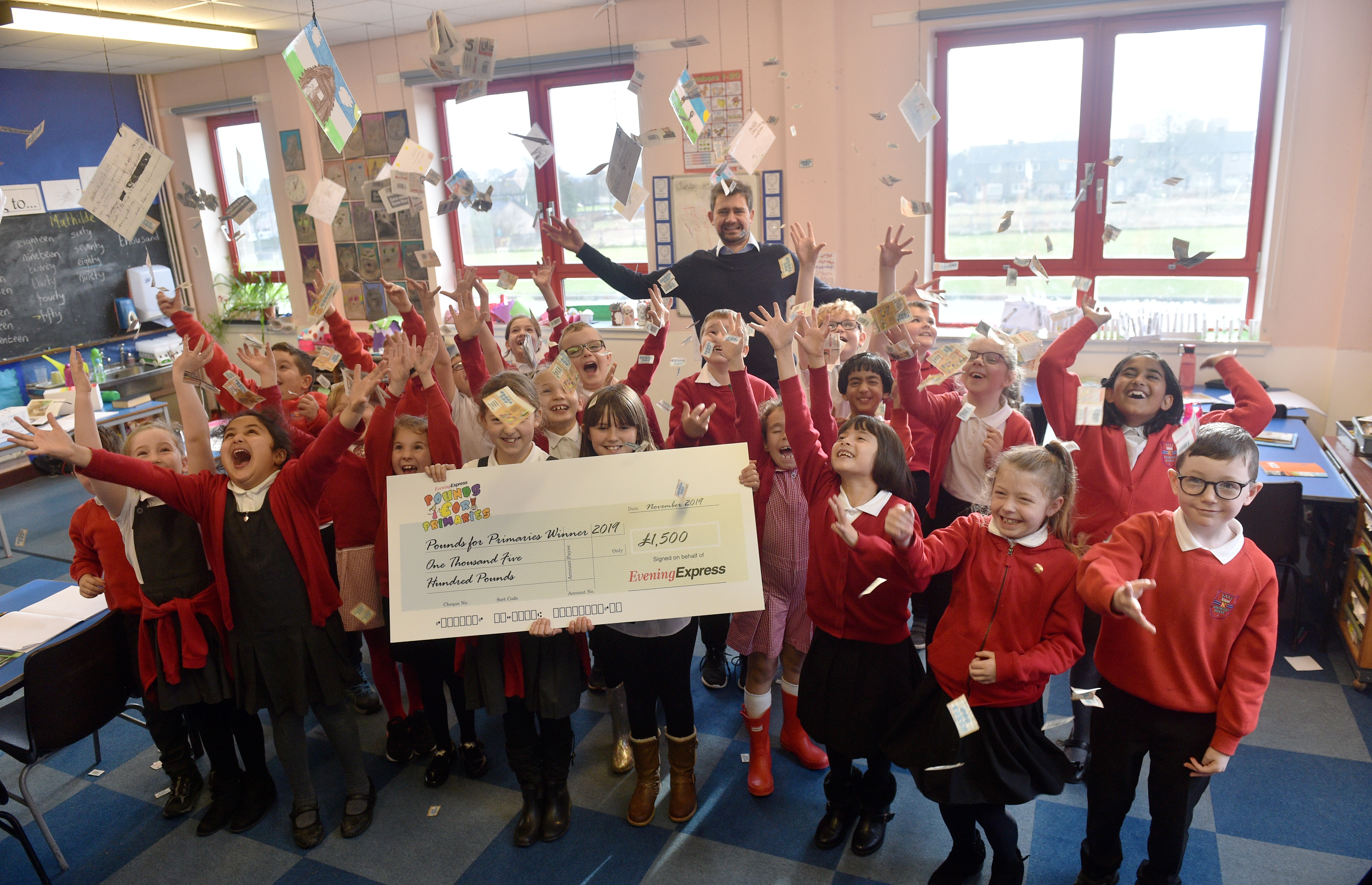 Celebration time for Mr Roach's P4 class at Kingsford Primary School with their cheque from the Evening Express Pounds for Primaries competition. Pictures by Darrell Benns