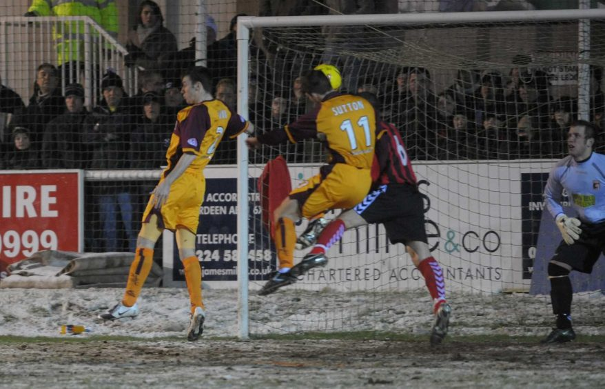 Motherwell's John Sutton scores in the first half.