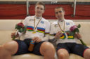 Neil Fachie (right) and the pilot Peter Mitchell shows their gold medals during day two of the UCI Para-cycling Track World Championships at the Aguascalientes Bicentenary Velodrome, Aguascalientes, Mexico.