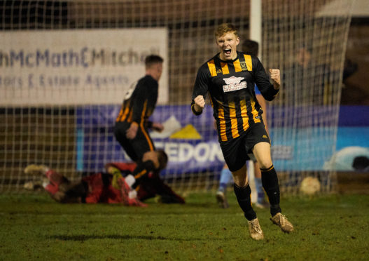 Huntly Logan Johnstone celebrates his goal.