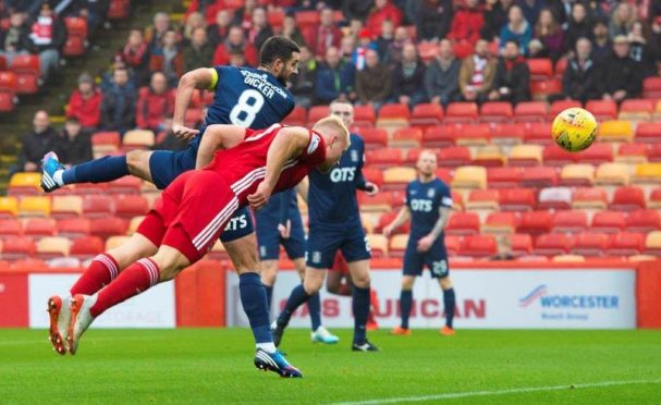 Striker Curtis Main heads home his first competitive goal for Aberdeen.