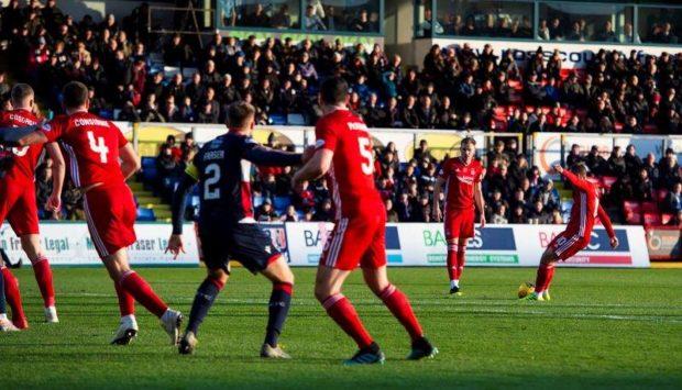 Niall McsGinn nets a free-kick to make it 1-1 against Ross County in Dingwall.