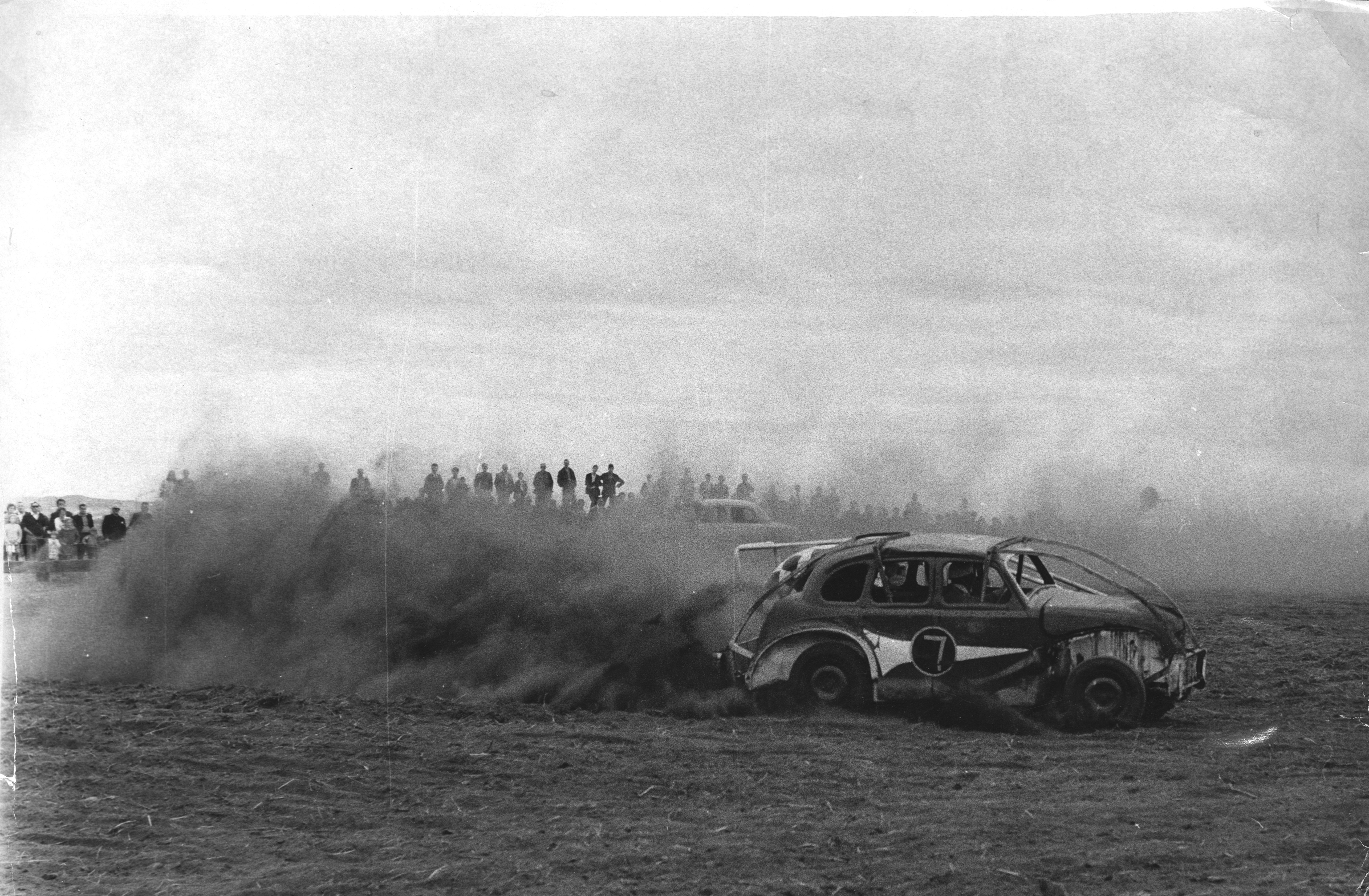 """Motorsport  Car Racing 1967-08-26 (C) AJL  """"Before the final of the day's events could be run police stopped the races, after crash barriers gave way at Aberdeen Stock Car Racing Club's first meeting yesterday. And on top of that many of the thousands who flocked to Catto's Park, Bridge of Don, to see the races were disgruntled to find that they were being given a shower bath of grit and dust - a sample of it is pictured above. As the cars roared round the track so much dust was thrown up into the faces of the crowd that many left after seeing only a few races. The club's secretary, Mr Bob Sharples, said last night: """"It was admittedly a bit of a shambles, but we will learn from our mistakes."""" Picture taken 26 August 1967.  Used: P&J 28/08/1967; EE 29/05/2018."""