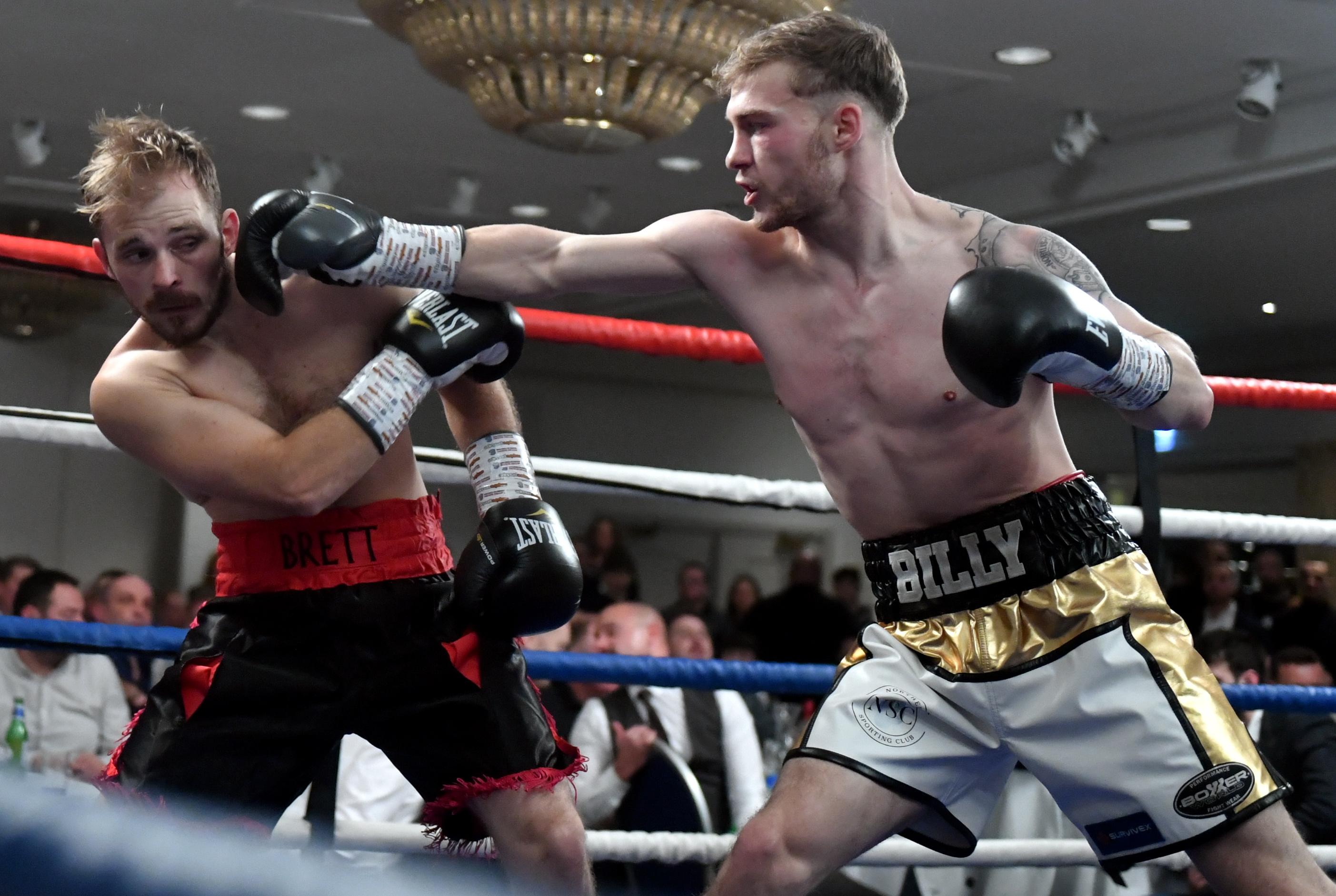Billy Stuart lands a shot on Brett Fidoe Picture by Chris Sumner