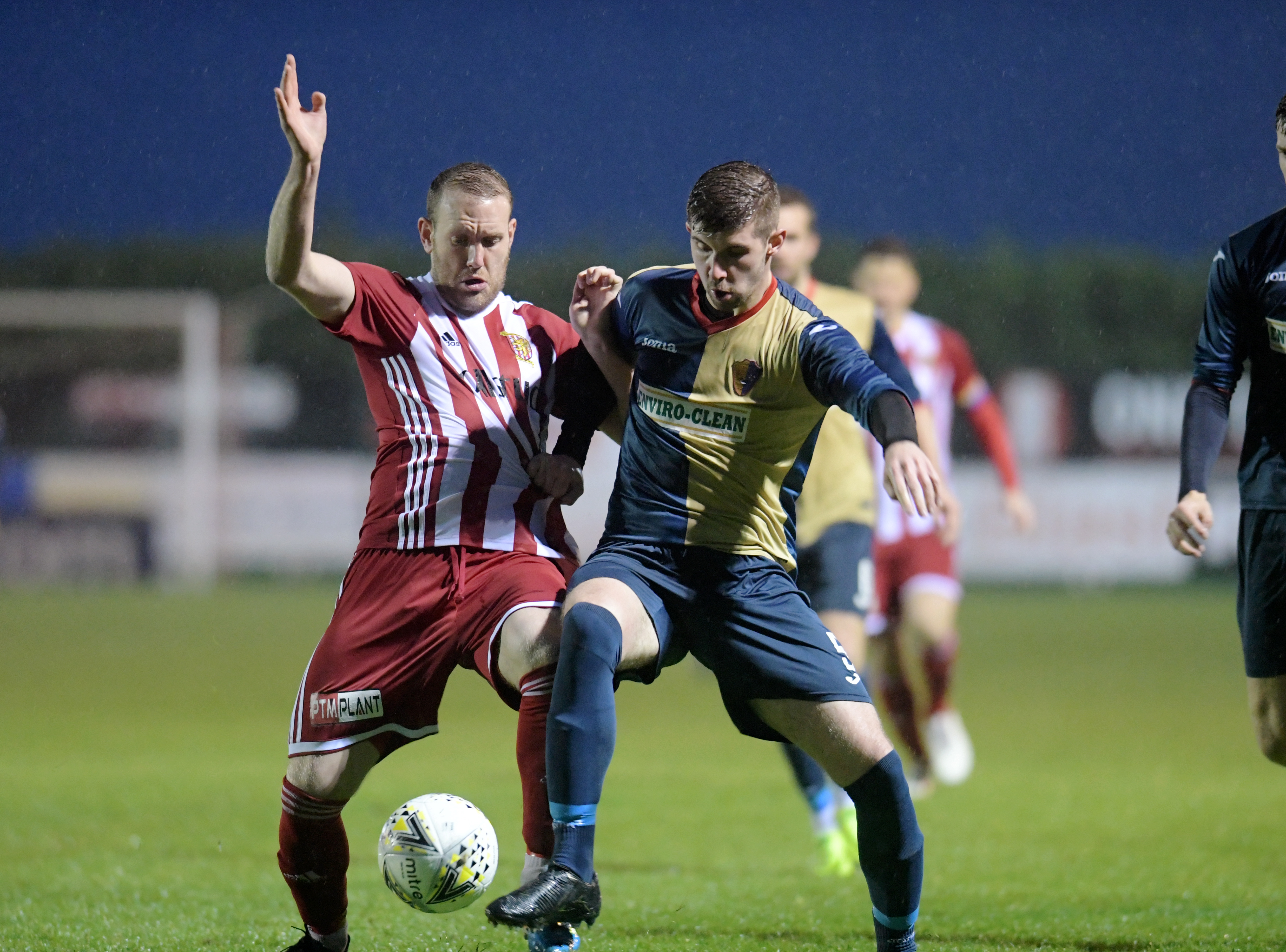 Formartine's Garry Wood and East Kilbride's Sam Fisher.  Picture by Kath Flannery