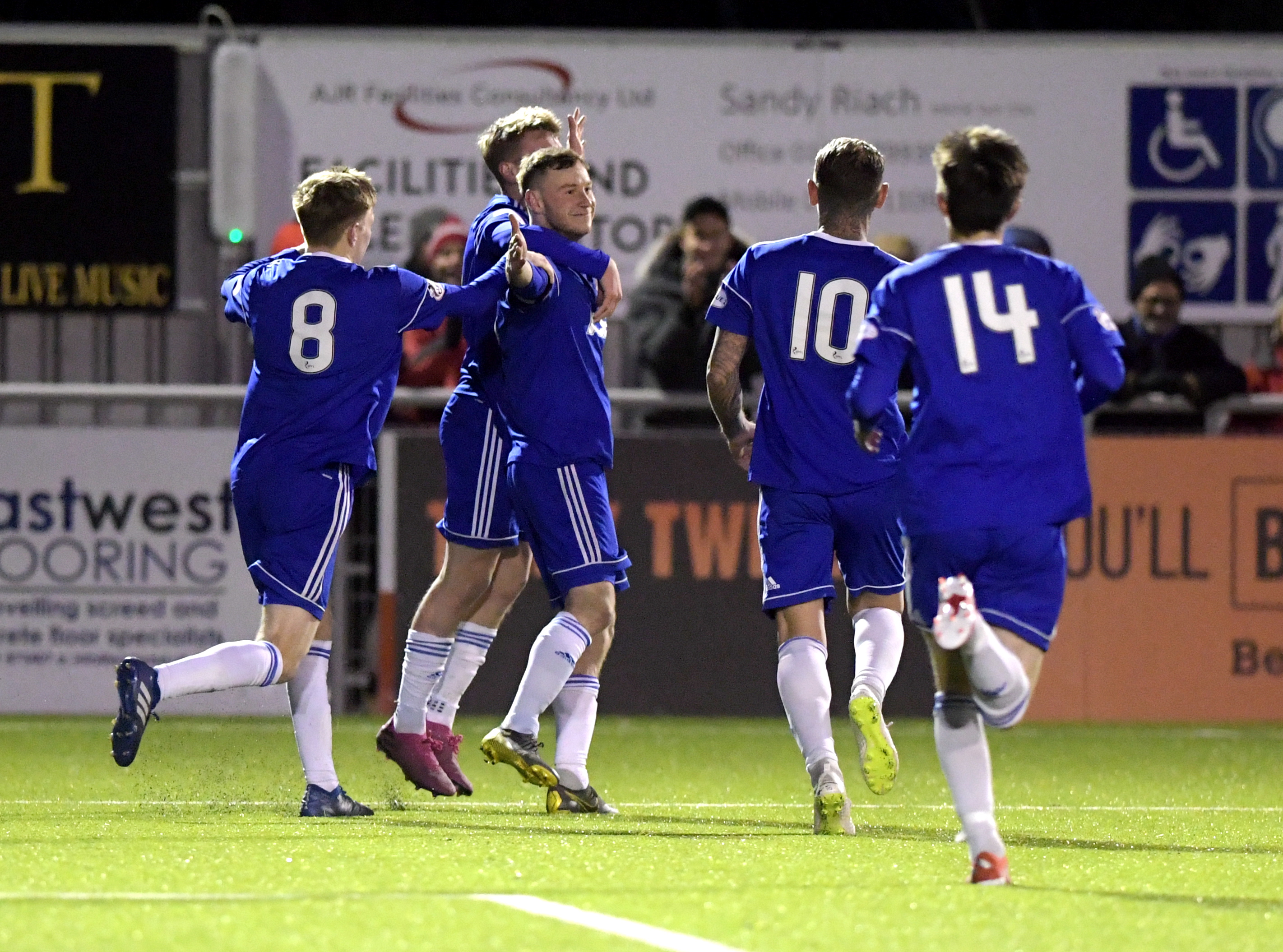 Cove celebrate Megginson's goal. Picture by Kath Flannery