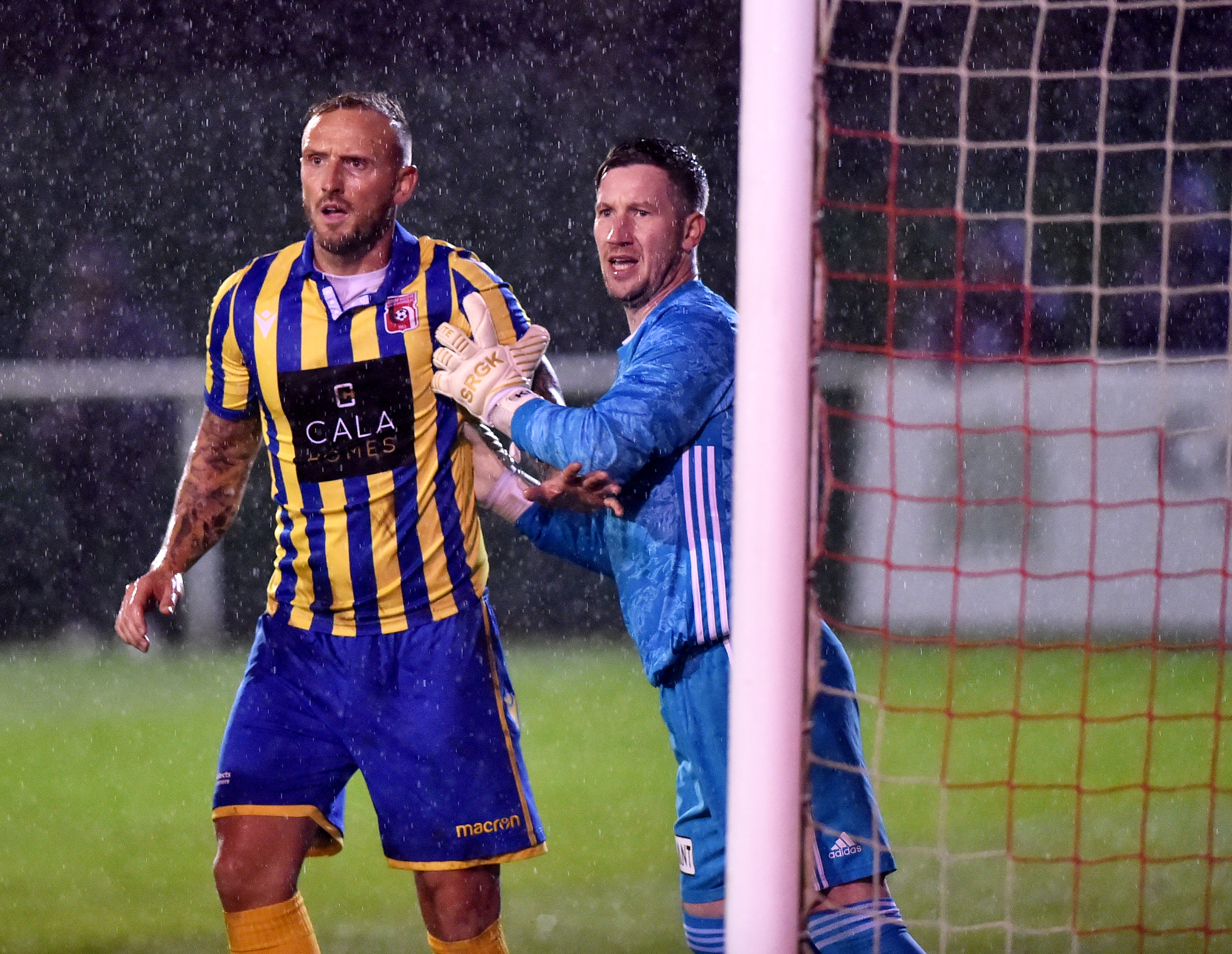 Jonny Smith jostles with Formartine keeper Kevin Main.  Picture by Scott Baxter