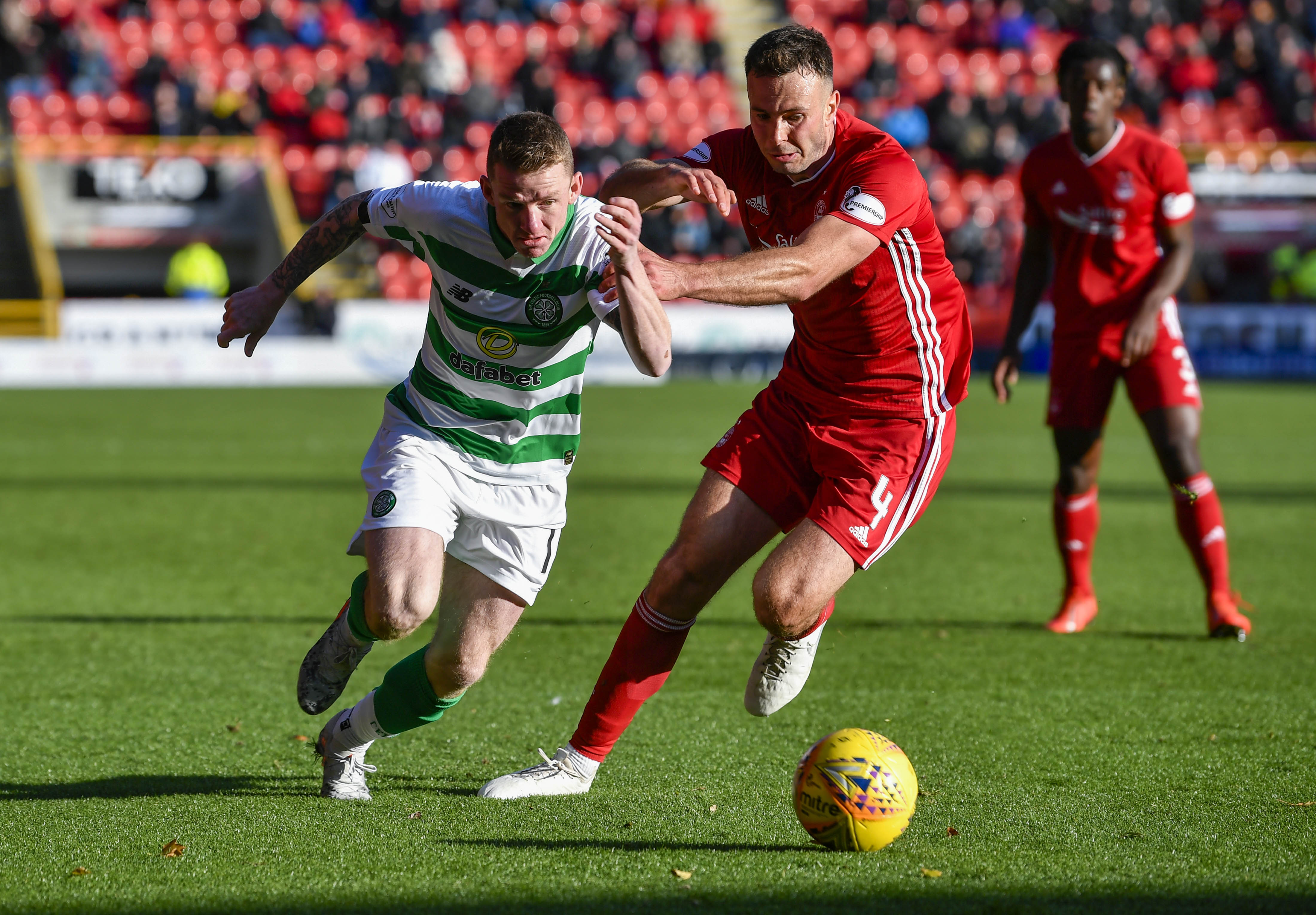 Aberdeen's Andrew Considine in action with Celtic's Jonny Hayes.