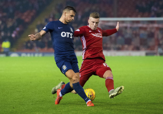 Kilmarnock's Eamonn Brophy, left, is pictured in action with Aberdeen's Lewis Ferguson.