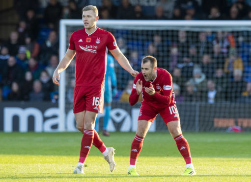 Aberdeen's Niall McGinn, right, celebrates his goal to make it 1-1 with Sam Cosgrove during the Ladbrokes Premiership match between Ross County and Aberdeen at the Global Energy Stadium.