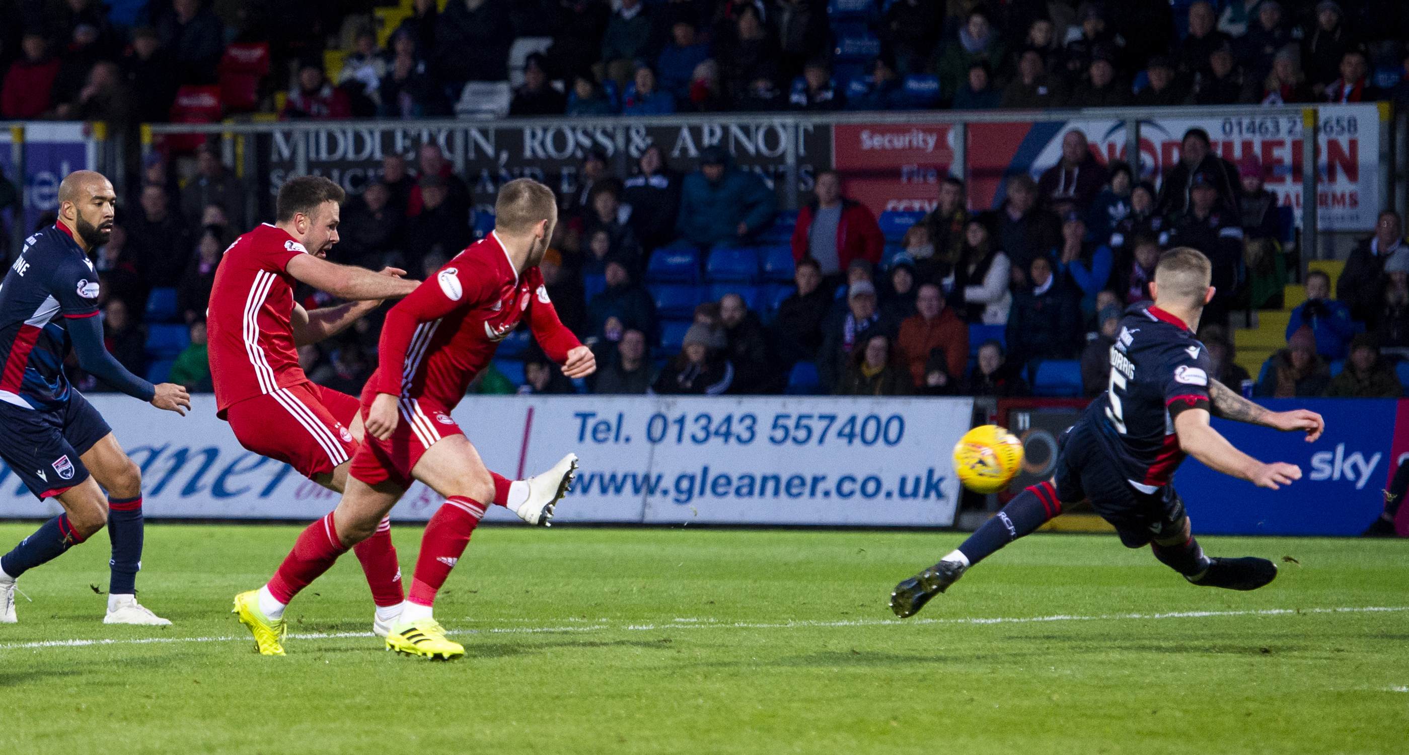 Andy Considine, left, scores to make it 3-1 during the Ladbrokes Premiership match between Ross County and Aberdeen.