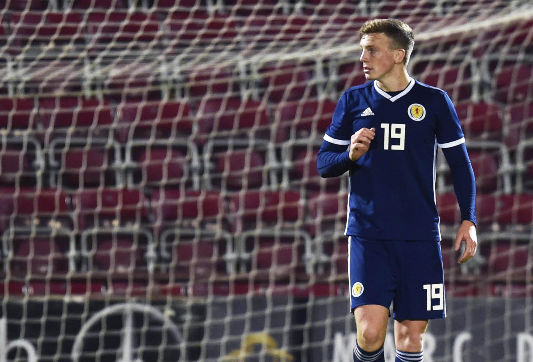 Scotland's Lewis Ferguson is pictured looking dejected.