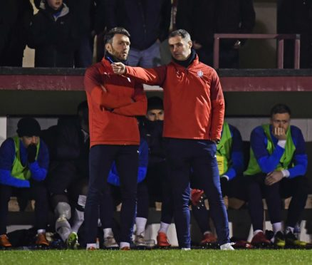 Lee Miller, left, and David McCracken during the Scottish Cup Third Round tie between Linlithgow Rose and Falkirk at Prestonfield of Friday, which Falkirk won.