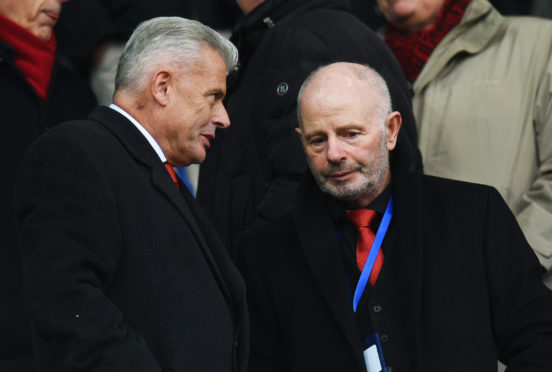 Aberdeen owner Stewart Milne and Aberdeen vice-chairman Dave Cormack, left, at the game.