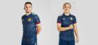 The new Scotland home kit modelled by John McGinn and Erin Cuthbert.