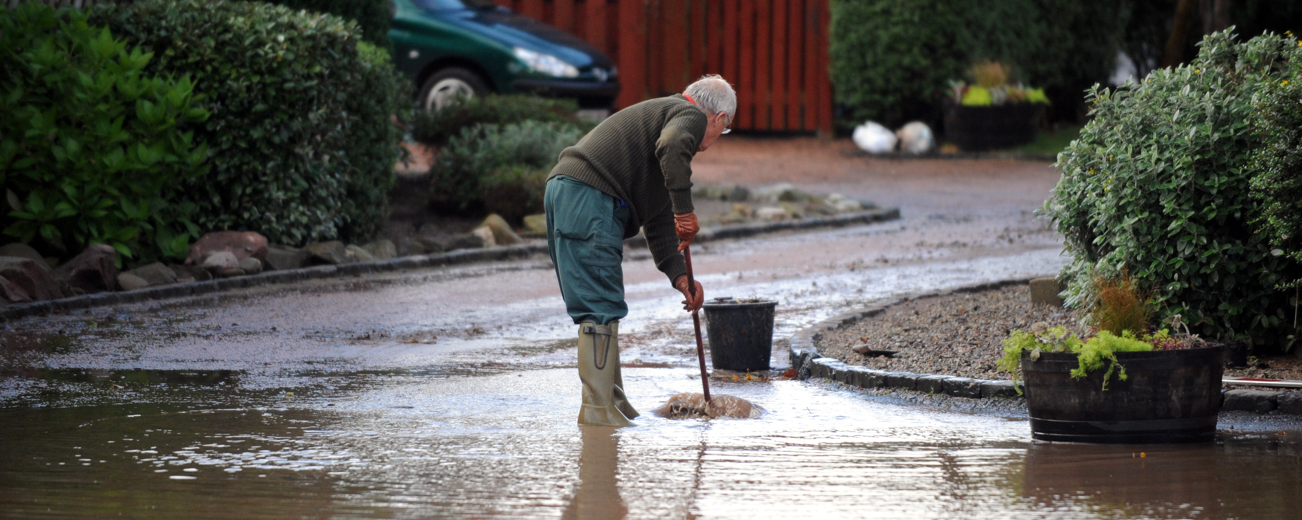A resident of Stonehaven cleans up after a previous flood.