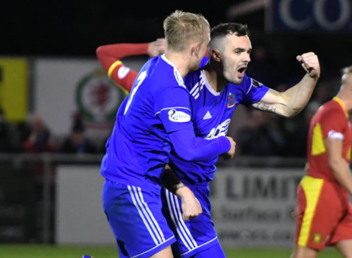 Scott Ross, right, celebrating a Cove goal.  Picture by Chris Sumner