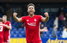 Aberdeen's Shay Logan hit back at the social media comments, which included racism from a 15-year-old boy
