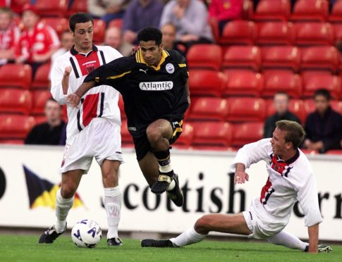 Hicham Zerouali, centre, bursts through the Bohemians defence in European action for the Dons.