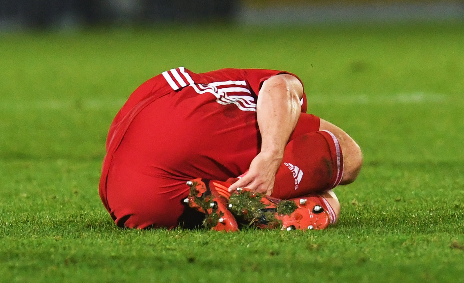 Aberdeen's Craig Bryson lies injured at St Johnstone.