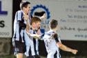 Owen Cairns celebrates scoring. Picture by Chris Sumner