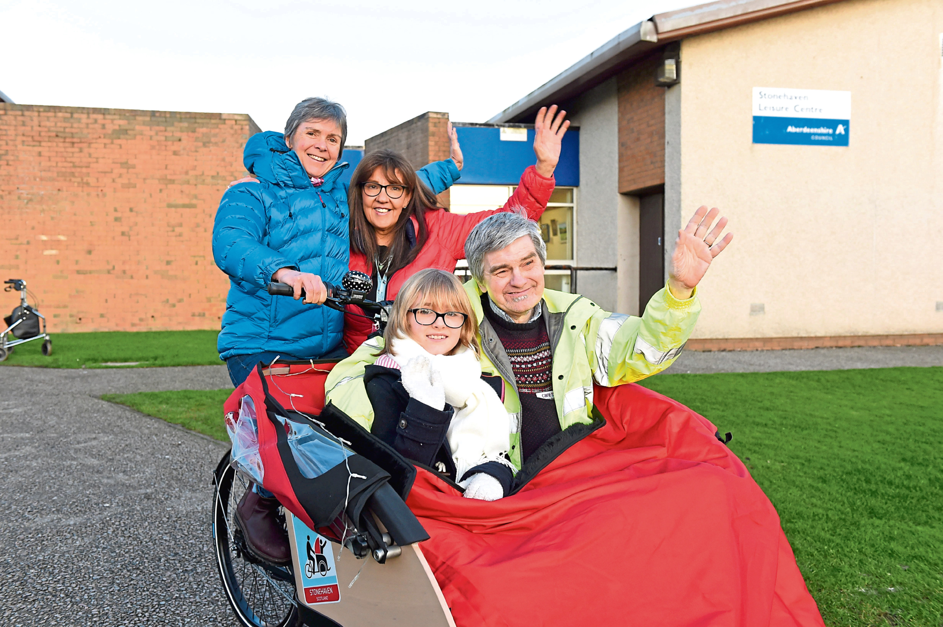 Pictured with the new Stonehaven Trishaw are, from left back, Mo Howard and Christine Bell of  Cycling Without Age Scotland. Seated are Ava and Doug Duffus