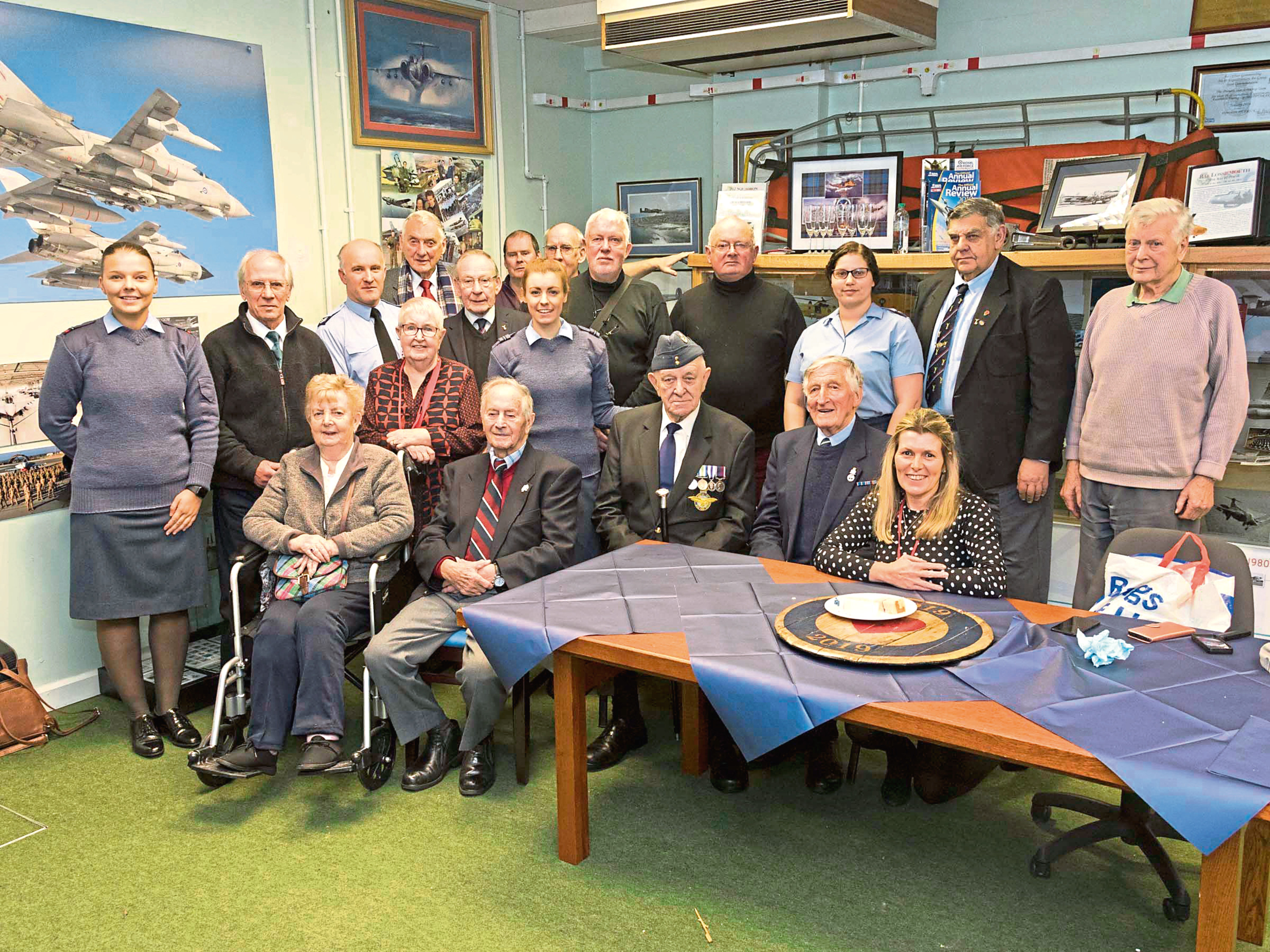 Paul Bohan, seated second from left, with RAF Lossiemouth personnel