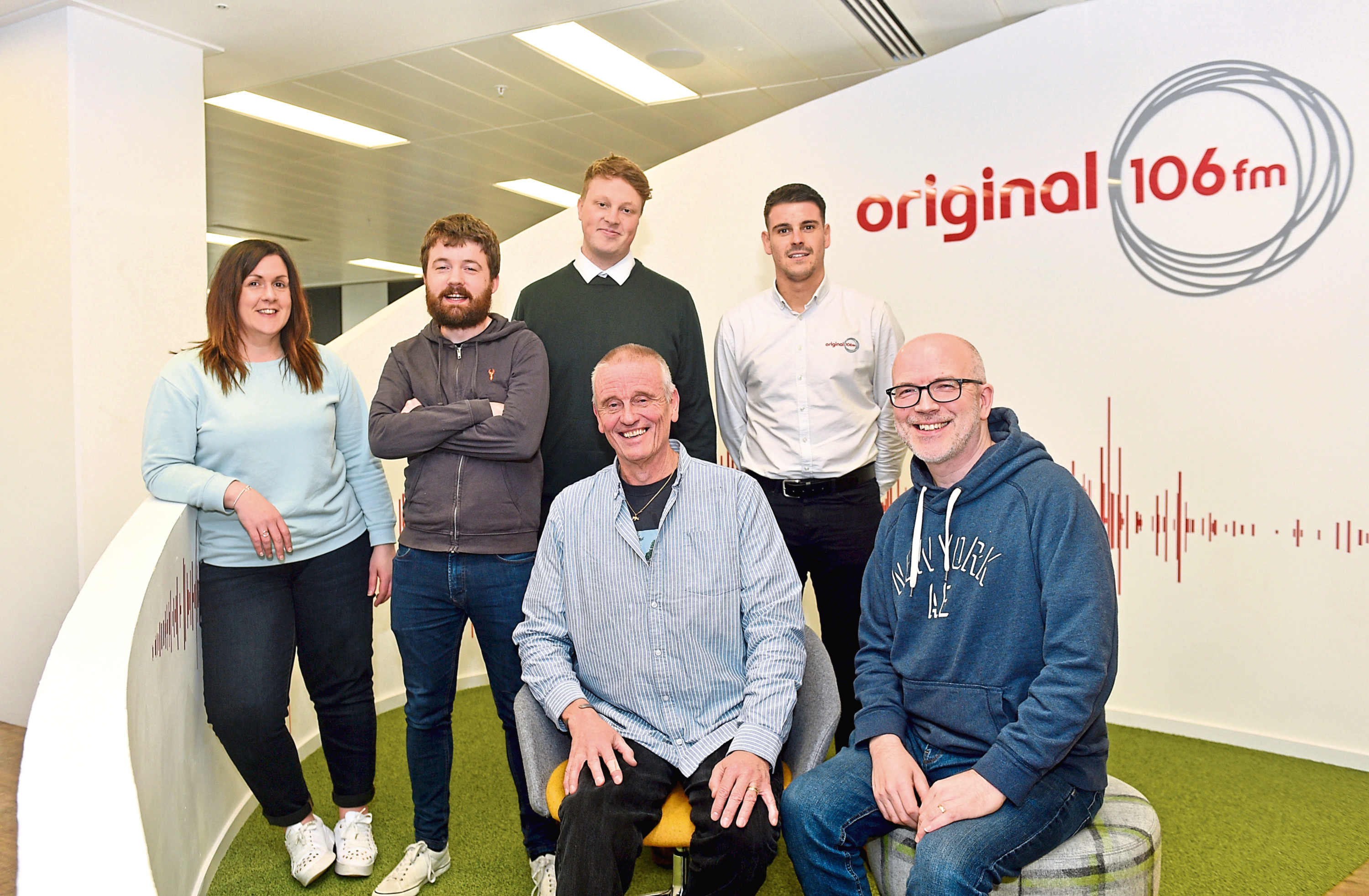 Members of the Original 106fm team with Dave Simmers from CFine at the Original studios as part of the launch of Original's Christmas appeal