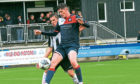 Turriff United's Keir Smith, centre.