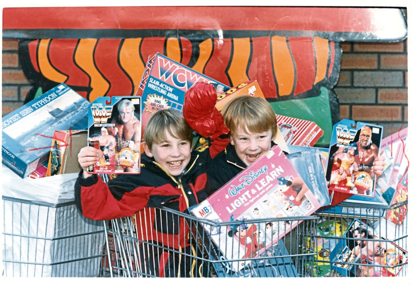 The Boyd brothers, eight-year-old Stephen and six-year-old Mark, check out toys to be gifted to children less fortunate than themselves in Grampian TV's annual toy appeal