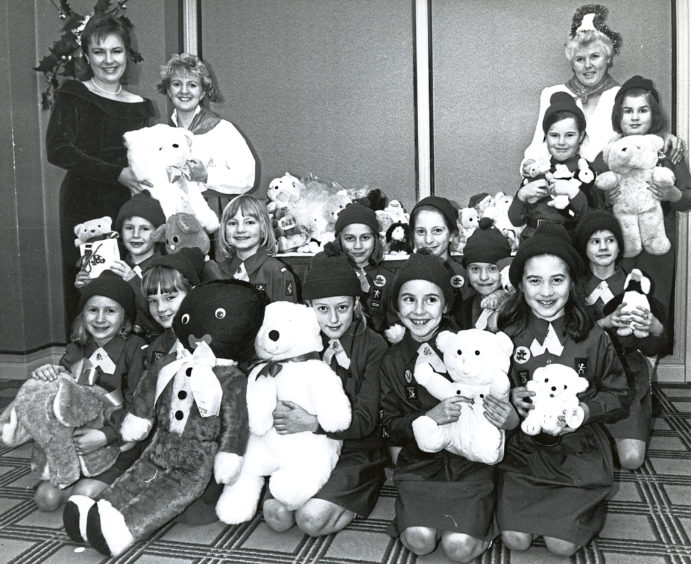 A Christmas appeal gifts soft toys with help from the 39th Queens Cross Brownies