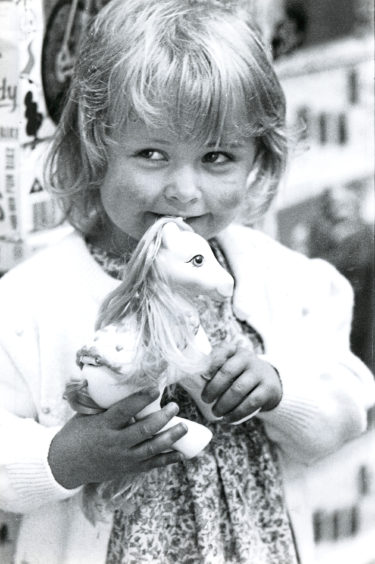 Aberdeen's Kyla Higgs, 2, happily clutches her new favourite toy, My Little Pony