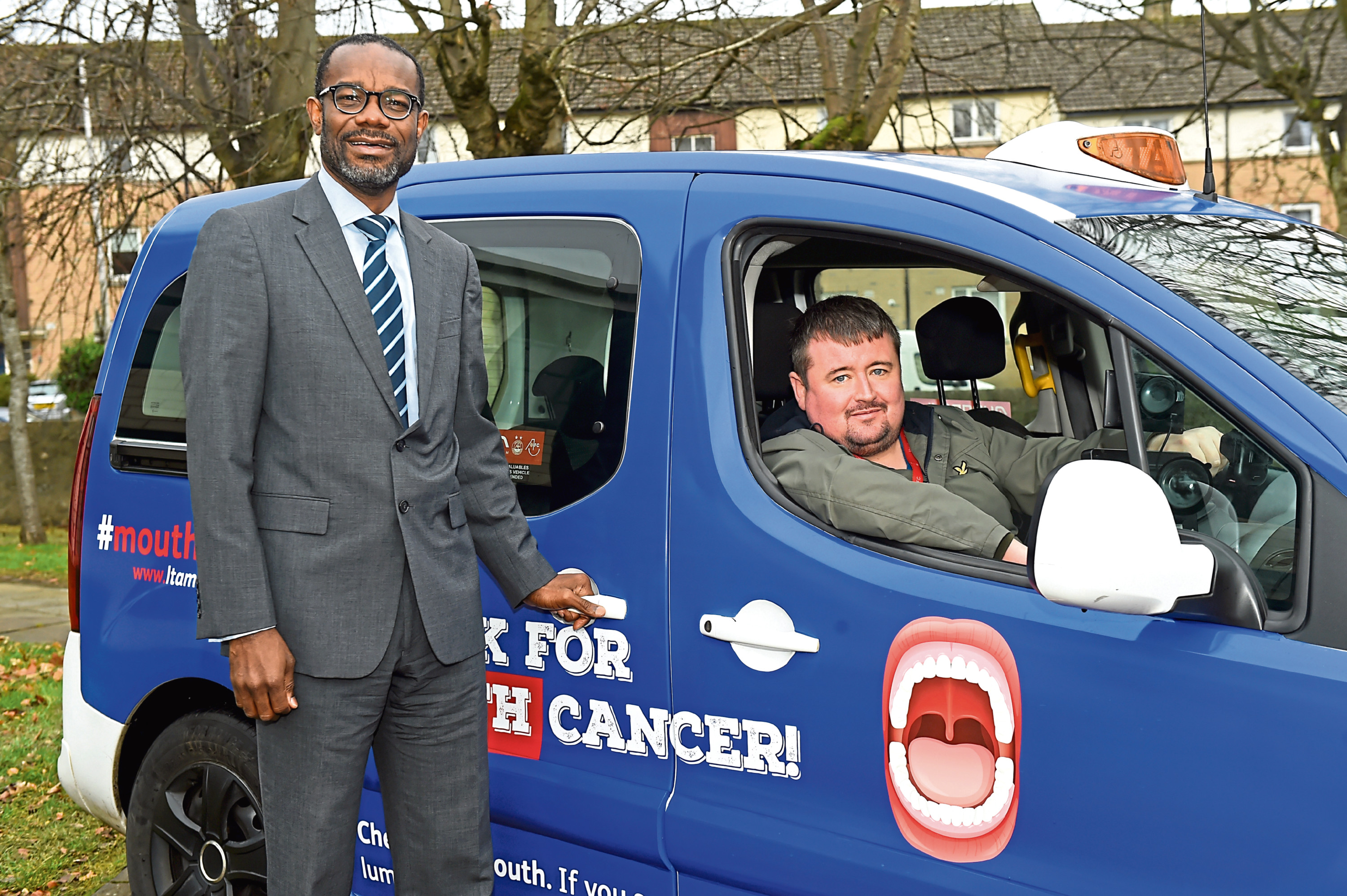 From left, Jonathan Iloya, consultant in Dental Public Health, and taxi driver Mark Muirden