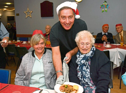 Blue Toon manager Jim McInally serves up lunch to Morag McBain, left, and Jenny Ritchie