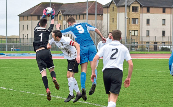 Scramble at the Fauldhouse goalmouth with keeper Jordan Allan and Bridge of Don's Jack McLlveen. Picture by Colin Rennie