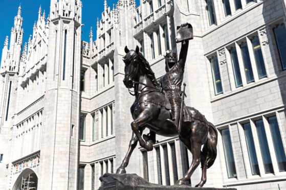 The statue of King Robert the Bruce outside Marischal College