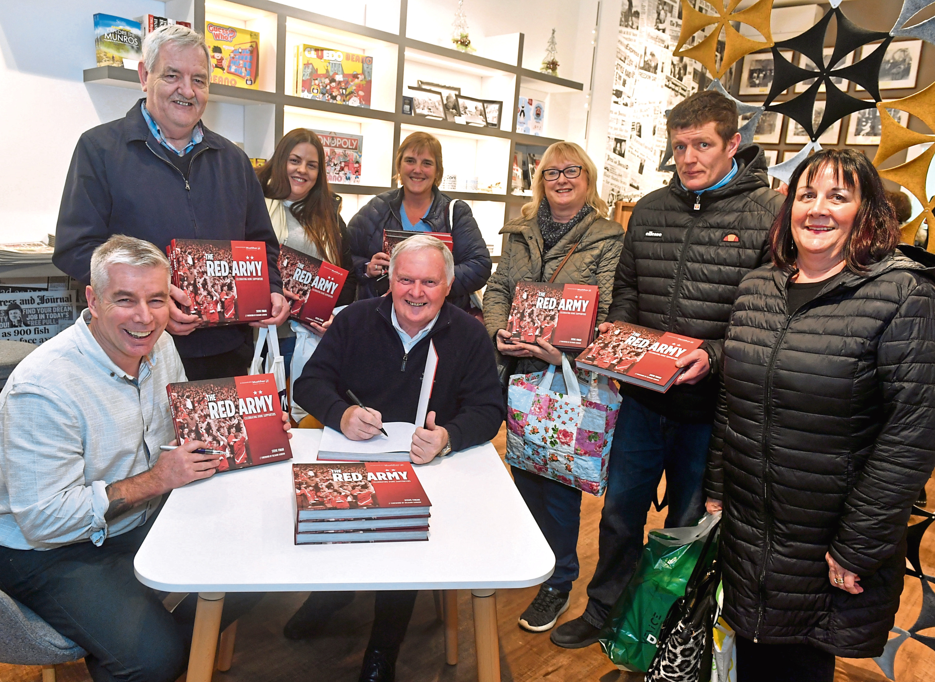 CR0017447 Picture from The Red Army book signing at the Journals shop, featuring Evening Express columnist Joe Harper and author Steve Finan.  Steve and Joe pictured with members of the public. Pic by...............Chris Sumner Taken...............11/12/19