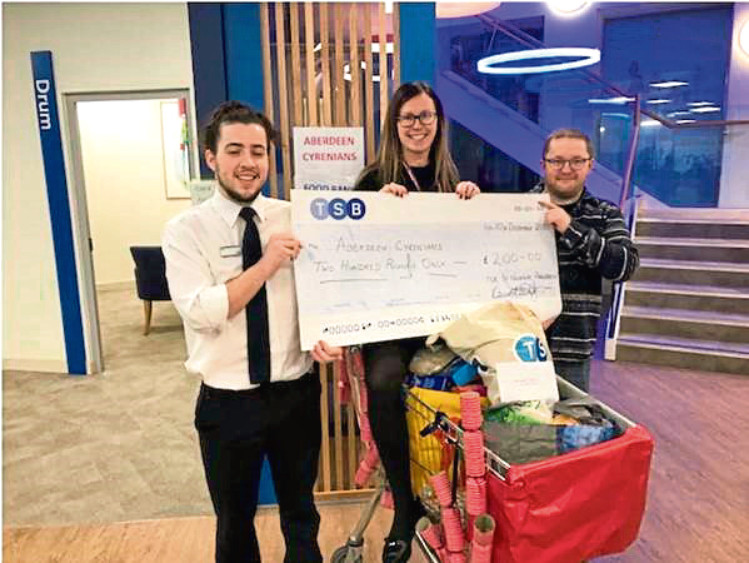 TSB's Dylan Thain hands the cheque to Bryony Shepherd
