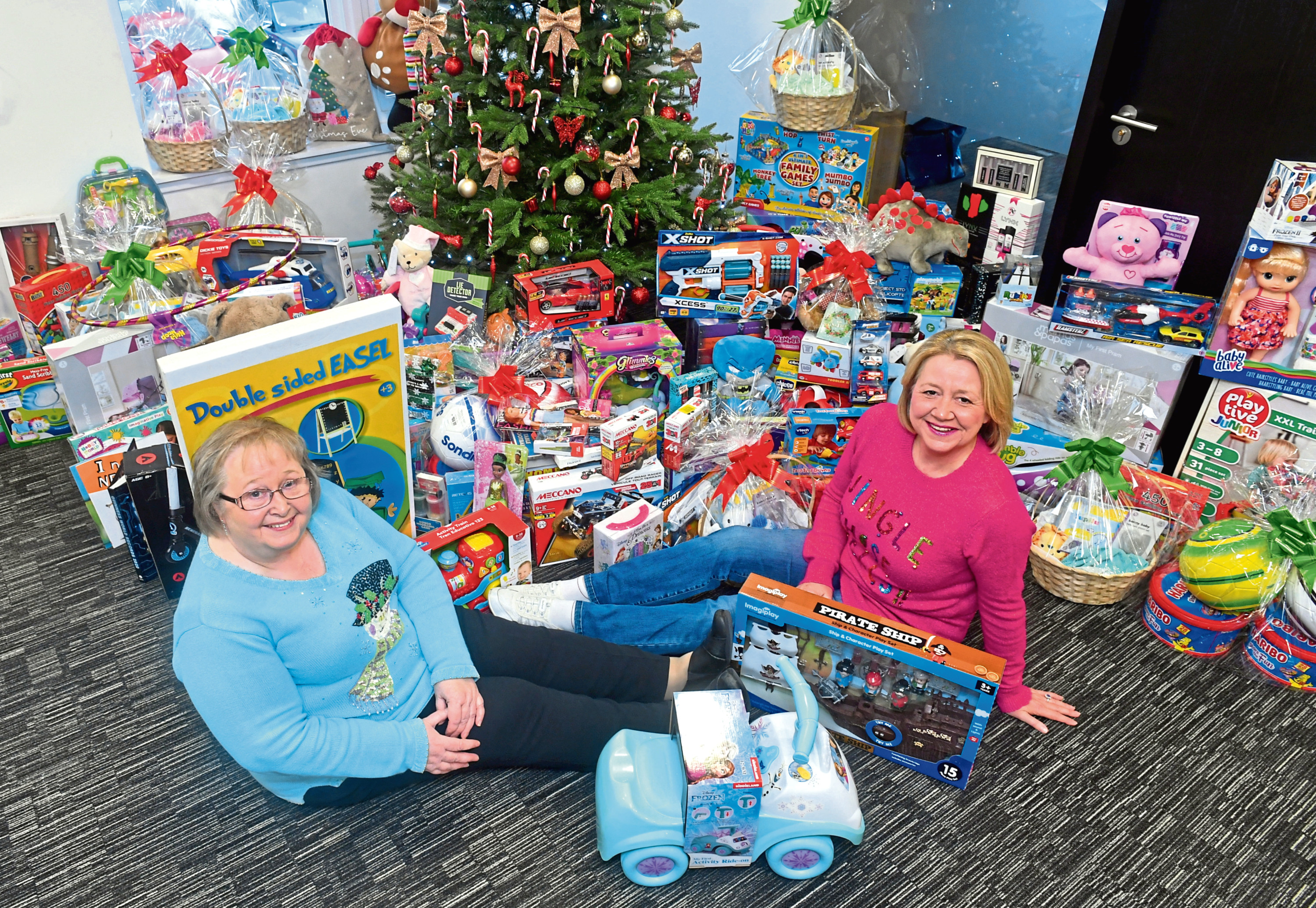 Pat Davies, left, and Mandy Dinnie with some of the gifts donated through the OneSubsea appeal