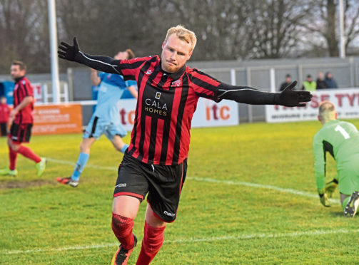 Locos' Chris Angus celebrates. Picture by Kath Flannery