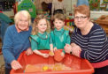 Anthea Whitelaw, first playgroup manager, with Sienna Petrie and Sam Jones, both three, and Alison Murphy
